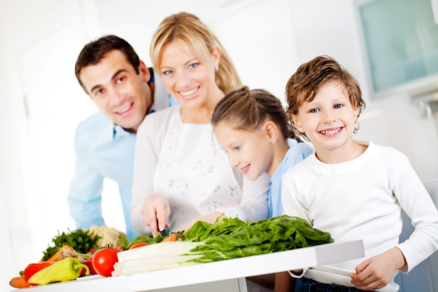 Happy family are preparing a healthy dinner at home.